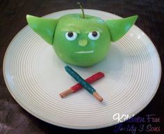 green apple + mini marshmallow + mini chocolate chips + peanut butter + tooth pick = yoda-licious apple snack!