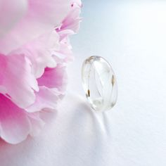 Tiny hand placed dandelion seeds in a resin stacking ring band.Beautiful detail can be seen in each tiny seed.Wear wishes on a ring! Available in Various Sizes.