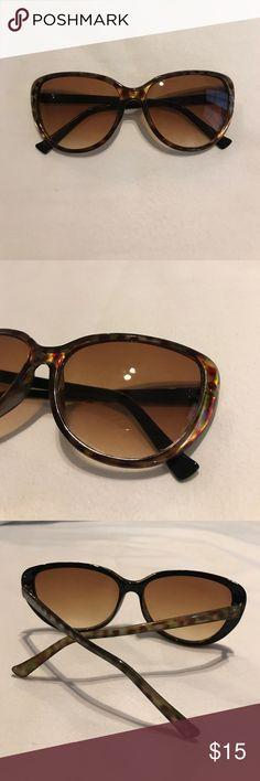 BCBGeneration SUN GLASSES dark colored BCBGeneration sun glasses. Deep red/green. Cat eye shaped BCBGeneration Accessories Sunglasses