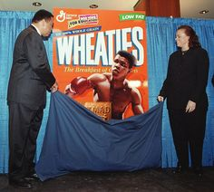 """Muhammad Ali and his wife Lonnie unveil the special edition Muhammad Ali Wheaties' box which marks the cereal's 75th anniversary on Feb. 4, 1999. Wheaties, """"The Breakfast of Champions,"""" is honoring the man widely accepted as one of the greatest athletes of all time."""