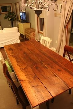 I would love one of these long enough to seat my entire family.  Love this table.