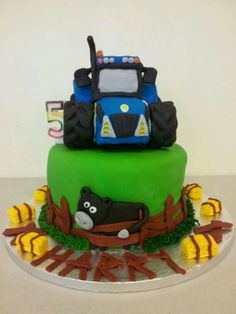 new holland tractor cake...only blue will do!tractor made from rice krispie treats and covered in fondant