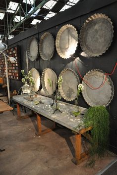 1920's zinc flower shop table from Espace Nord Ouest.. love the ginormous zinc pie dishes