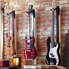 light your guitar mount, like the wall arrangement, good idea of how to display hubby's hobby