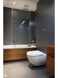 podwieszana toaleta o zaokrąglonych kształtach połączenie szarości z drewnem