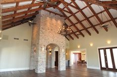 Great room of the Churchill Oaks clubhouse featuring; reclaimed heart of pine floor, Old Chicago brick, reclaimed beams, elegant chandeliers and wall sconces