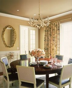 Warm tan and gold create a welcoming atmosphere in this traditional dinning room. We recommend our Dapper Dingo  KM4612 to recreate this look. #PaintColors #Fall #Homedecor