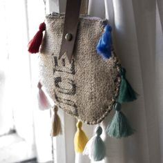 This is a small bag made from a recycled coffee bean burlap sack. It's got a silk lining in bright gold color,a leather strap for wearing in hand.It's decorated with a made by hand multicolor tassels.Have a zipper open.Unique!About  18cm circle and 35cm strap handle.Малка ръчна чанта,изработена от рециклиран конопен чувал.Украсена с ръчно направени пискюли,с кожена дръжка за носе�... Burlap Purse, Work Inspiration, Reusable Tote Bags, Purses, How To Make, Handmade, Fashion, Drawing Rooms, Hand Made