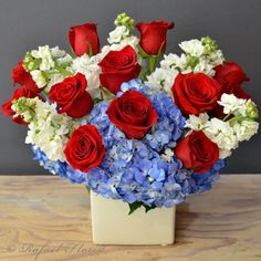 Amazing Grace Red white blue flower arrangement designed in a mirror cube vase. This design features ruby red roses, blue hydrangeas, and scented stocks Get Well Flowers, All Flowers, Summer Flowers, Pretty Flowers, Blue Flower Arrangements, Flower Arrangement Designs, White And Blue Flowers, Flower Delivery Service, Order Flowers Online