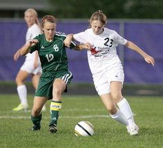 Jackson High School junior Emily Justus, right, fights for control of the ball in a Sept. 12 game against GlenOak.
