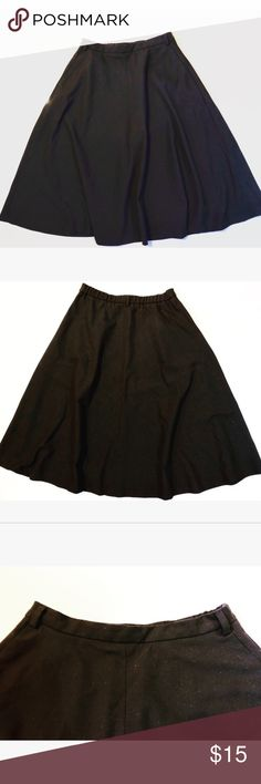 Black skater skirt It has two belt loops in the front and one in the back. It has a zipper on the side and no it's not a white stain on the first picture it's just the light. First picture is of the front and the second is of the back. Zara Skirts Circle & Skater