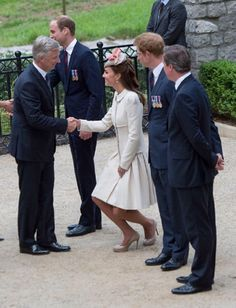 Catherine, Duchess of Cambridge greets King Philippe of Belgium at St Symphorien Military Cemetery on 04.08.2014 in Mons, Belgium.