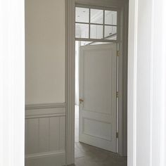 Bespoke door and panelled walls with glass panel above door to let light and shadows into hallway. Glass Panel Door, Sliding Glass Door, Panel Doors, Doors With Glass Panels, Glass Panel Internal Doors, Küchen Design, Door Design, Bath Design, Window Above Door