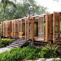 Brillhart Architecture's breezy Brillhart Residence in Miami takes inspiration from Tropical Modernism with wooden shutters. Brillhart Architecture's breezy Brillhart Residence in Miami takes inspiration from Tropical Modernism with wooden shutters. Tropical Architecture, Architecture Design, Landscape Architecture, Vernacular Architecture, Beautiful Architecture, Wooden House Design, Wooden Houses, Bamboo House Design, Wooden Buildings