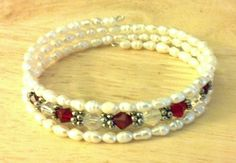 Memory wire bracelet with fresh water pearls, garnet and clear crystals with silver daisy spacer beads