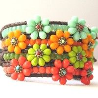 """4 Flower Power bracelets.""   These have a wonderful 1960's retro vibe thing going for them."