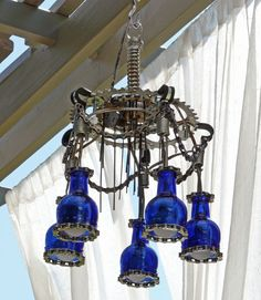 garden chandelier ideas   Outdoor Chandelier Lighting made with Trash and Krylon Paint Outdoor Chandelier Lighting, Driftwood Chandelier, Bottle Chandelier, Chandeliers, Diy Chandelier, Backyard Lighting, Home Lighting, Industrial Chandelier, Lighting Ideas