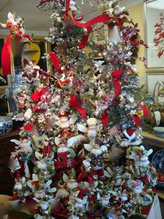 Mark Roberts Fairies Float atop and throughout snowy trees they are decorating with bright holiday ribbon!