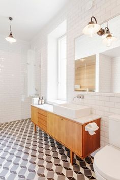 encaustic tile floor with footed vanity white subway tile and brass fixtures. I dont like sink