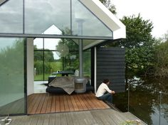 This prefab cabin has a fold-out wall that allows lake access from the living room. Courtesy of: 2by4-Architects