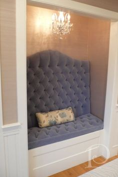 upholstered nook with tufted cushion chandelier converted closet in foyer