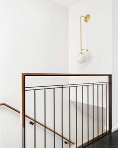 Our Ramona Sconce in a fantastic whole house project photographed by Wood Railings For Stairs, Indoor Railing, Loft Railing, Staircase Railing Design, Interior Stair Railing, Modern Stair Railing, Iron Stair Railing, Iron Spindle Staircase, Wood Stair Handrail