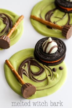 Melted Witch Bark - a cute and fun Halloween treat everyone will love! { lilluna.com } All you need to make these fun treats are - green candy melts, mini chocolate chips, pretzel sticks, mini reeses, Halloween oreos, and Hershey Hugs!