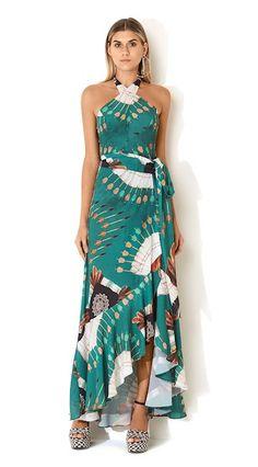 Se pretende um visual elegante e fora do padrão, esse vestido é perfeito. Ele mistura a sofisticação com recortes modernos que irão garantir uma produção surpreendente. Escolha bem o salto alto e acessórios e arrase! - VESTIDO LONGO DECOTE CRUZADO COCAR KARAJA » Vestidos