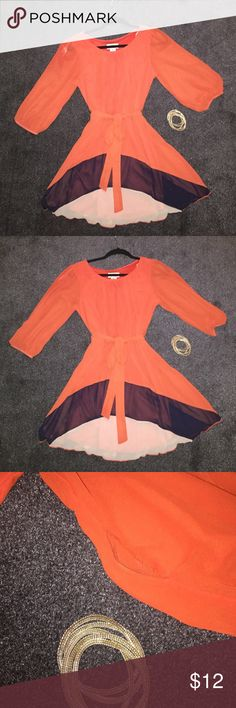 Flowy mini dress Orange NWOT ✨ This dress is super cute. Cinched arms and an airy flowy sleeve. It moves and twirls right along w/you. Has a tie around the waist and sits above the knee. It's a wonderful summer dress. There's one small defect. A hole in the left sleeve. If you're good with a needle and thread this is the dress for you. Never worn and is brand new without tags. No smells or stains. Didn't realize the hole till it was too late to take back. A little love for a great dress…