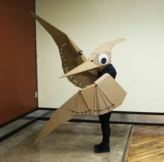 the pterodactyl is lisa glover& second wearable cardboard creature, for mor. Cardboard Costume, Cardboard Mask, Cardboard Sculpture, Cardboard Crafts, Cardboard Model, Dinosaur Costume, Dinosaur Party, Pterodactyl Costume, Dinosaur Dinosaur