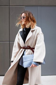 Love this oversize belted cream coat and her hair! #StreetStyle