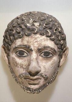 Painted plaster mummy portrait head. Roman Period. 3rd century A.D. | Seattle Art Museum