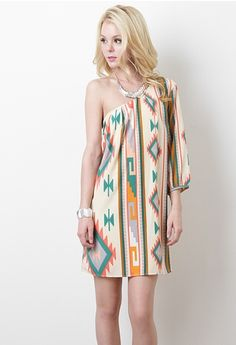 This one-shoulder dress features lightweight fabric with tribal print throughout, pleating at neckline, quarter-length bishop sleeve, and finished with full underlining.    100% Polyester. Lining: 100% Polyester.