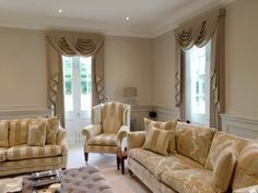 We created these stunning luxurious window treatments, including overlapping swags, matching tails with a slightly contrasting lining and bauble trim, and beautiful plain curtains to add elegance to the room in the Georgian home.