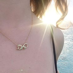 Infinity necklace shaped like a mermaid. Beautiful elegant mermaid jewelry for all ages! Perfectly priced available in Silver and Gold!