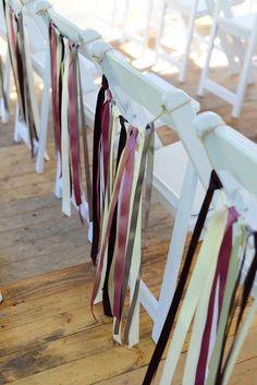 CHAIR DECOR.  Decorate chairs with simple lengths of ribbon in your wedding colour scheme. Our White Finesse Folding Chairs are perfect for achieving this look. Wedding Gallery | Hire Ideas & Inspiration | Your Event Solution | YES #weddings #YourEventSolution