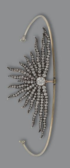 An antique diamond sunburst brooch/tiara, circa 1880 Designed as a rising sun, set throughout with old brilliant-cut diamonds, mounted in silver and gold, diamonds approximately 9.00 carats total, later tiara frame, brooch dimensions 3.7 x 10.1cm.