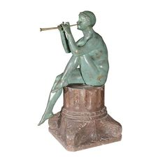 "MAURICE GUIRAUD RIVIERE (French, 1881-1947)    'Flute Player', a green patinated bronze sculpture depicting a nude female figure playing her flute and sitting on a stone base beautifully carved in the shape of a classical column fragment. Incised signature on the base.  Height: 24""  Width: 12""  Depth: 12"""