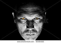 Dark And Moody Portrait Of Serious Looking Male Adult With Bright Orange Intimidating Eyes Stock Photo 92484502 : Shutterstock