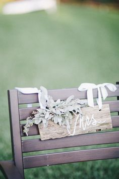 Sweet seat assignments | DIY Backyard Wedding in Jupiter from Michelle Kristine  Read more - http://www.stylemepretty.com/florida-weddings/2013/09/20/diy-backyard-wedding-in-jupiter-from-michelle-kristine/