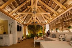 Natural elements of thatch, timber and travertine complement each other beautifully, reverberating nature in every corner. Outdoor Spaces, Outdoor Living, Timber Structure, Timber Cladding, Thatched Roof, Flooring Options, Living At Home, Rustic Decor, Backyard