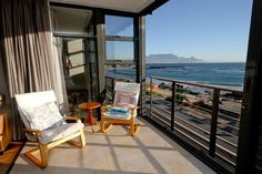 Sand en See 104 - Sand en See is a complex situated in Blouberg Village and on the beach with just a service road separating it from the sand and water.  Apartment 104 is on the first floor of the complex and guests have ... #weekendgetaways #bloubergstrand #southafrica
