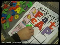 Independent building CVC words with magnetic letters! {Or use dry erase markers!} Over 20 word family mats + self-check cards and recording sheets to use for accountability! $