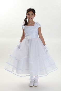 A truly amazing and timeless dress that everyone will love. This cap sleeve style dress is perfect for an upcoming wedding or special event. Take note of the intricate pleating throughout the satin bodice. The dress is youthful enough for younger children but sophisticated enough for junior bridesmaids. The full multi tiered, tulle skirt will surely make your little one feel like royalty and so will everyone else! Comes with a sash that attaches to side seams and ties in the back for the…