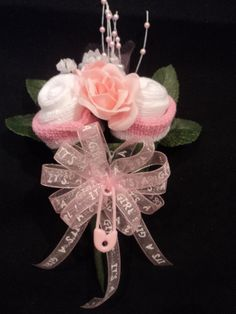 Baby Sock Rose Corsage Baby Shower Gift It's A Boy or Girl Ribbon. $10.99, via Etsy.