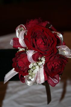 Red rose corsage on a bling bracelet