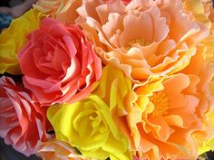 The women of our family used to get together & make crepe paper flowers like these, dip them in wax, let them cool and make arangements out of them for Memorial day.  A pleasant way to remember your loved ones as you make them a wreath, or boquet in their favorite colors.
