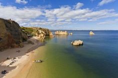 View of Dona Ana beach, Lagos, Portugal - Westend61/Getty Images