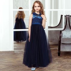 A lovely, long blue dress byJunonafor girls who have a special occasion to go to, with a lace top and full, tulle skirt, perfect for making an entrance in. It has beautiful crystals on the neck that sparkle in the light and a dramatic, oversized tulle bow at the back that is removable and secured with poppers. Girls will be able to keep little essential close at hand as it comes with a matching bag.