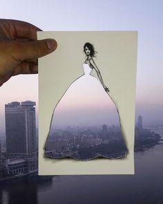 Este ilustrador de moda completa sus vestidos recortables con nubes y edificios (2ª parte)